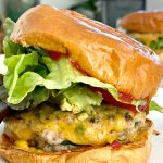 a Savory Turkey Burger with cheese, lettuce, ketchup