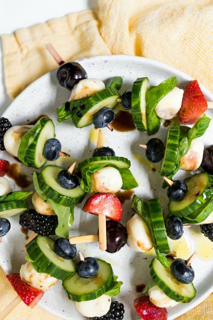 plate of Summer Cucumber Bites on a Stick drizzled with balsamic