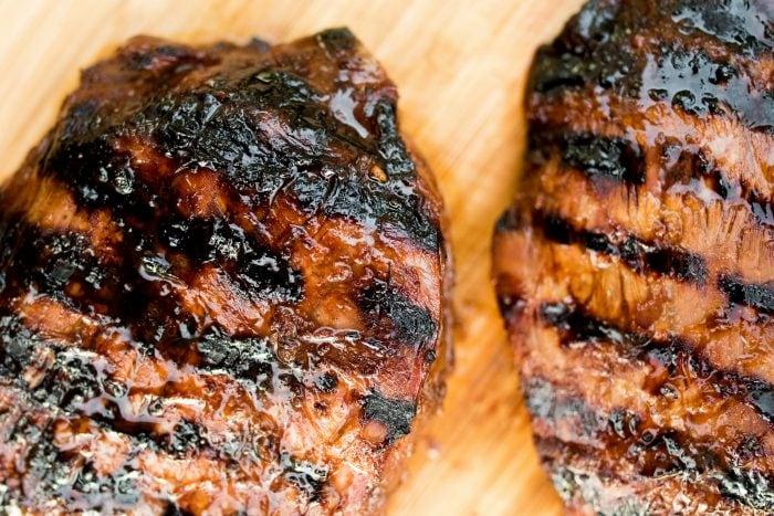 2 steaks marinated in Easy Balsamic Soy Steak Marinade