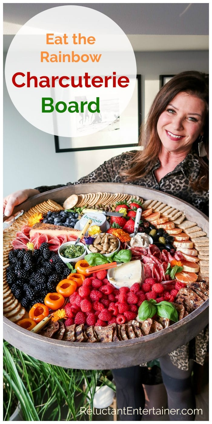 woman holding a big board wil colorful snacks