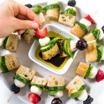 a beautiful plate of Mini Focaccia Sandwich Bites dipped in oil and balsamic