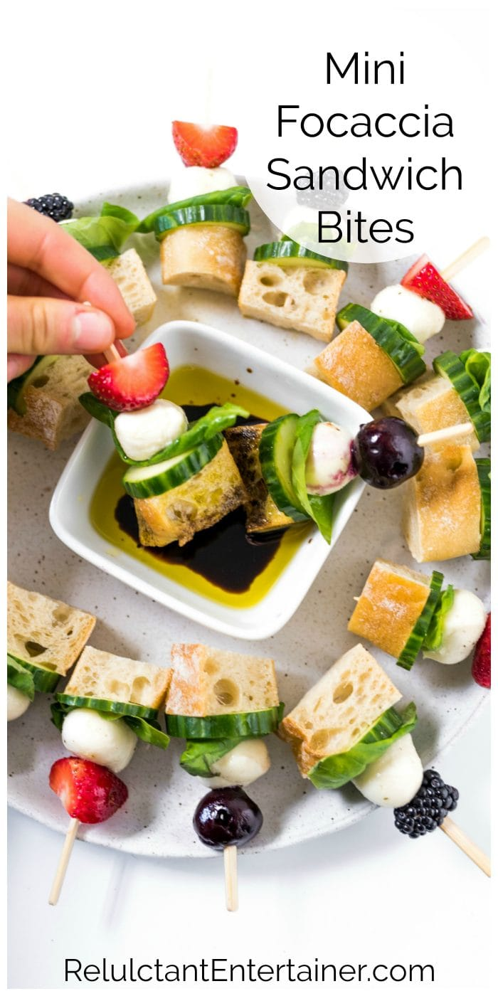 dipping a Mini Focaccia Sandwich in balsamic and oil
