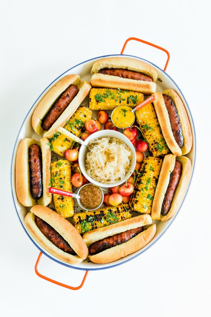 an oval Summer Brats and Sauerkraut Tray