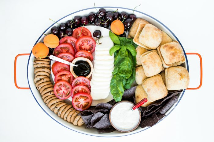 oval platter of deconstructed caprese sandwich slider ingredients