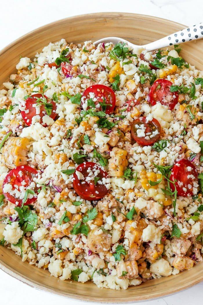 corn tomatoe salad garnished with cilantro