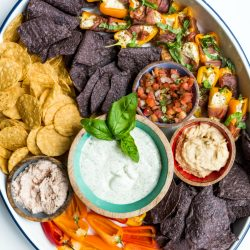 beautiful tray with chips and salsa and dips