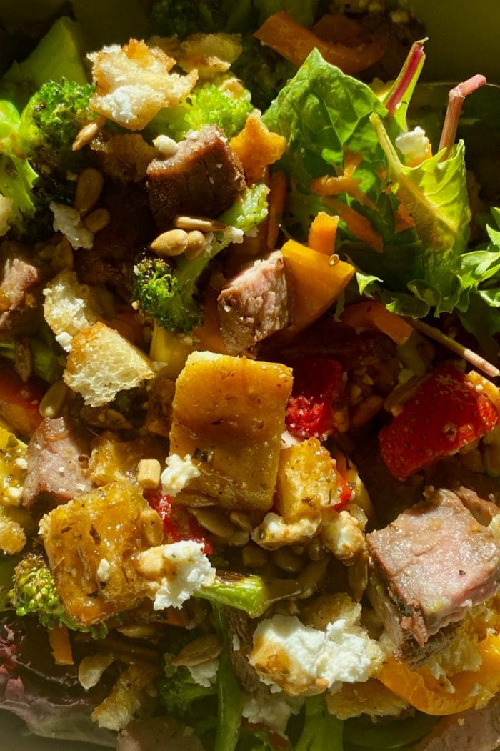 close up green salad with steak and homemade croutons