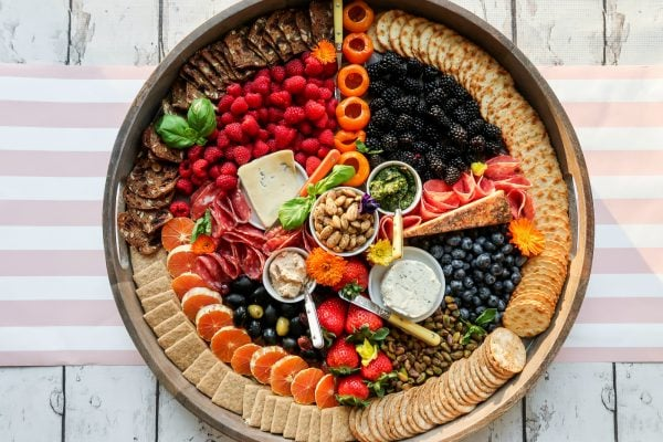 beautiful round board with rainbow colored foods