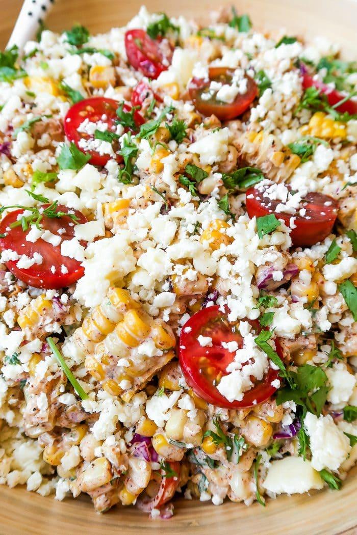 a bowl of summer corn tomatoe salad recipe