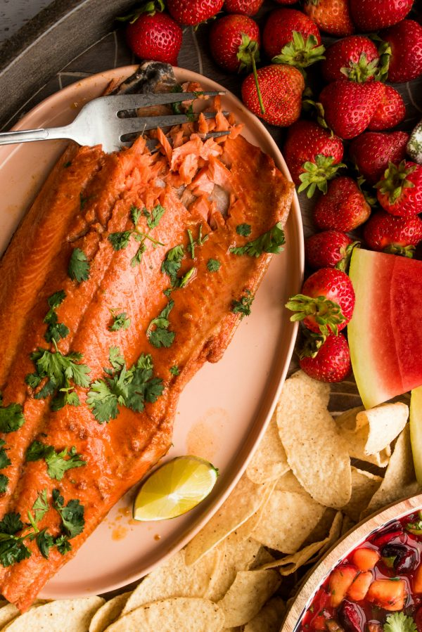 wild alaskan salmon fil cooked with garlic, lime, and garnished with cilantro