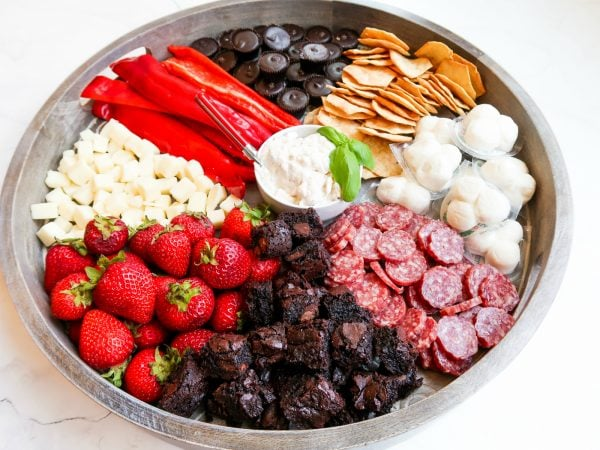 cauliflower dip in the middle of a snack board