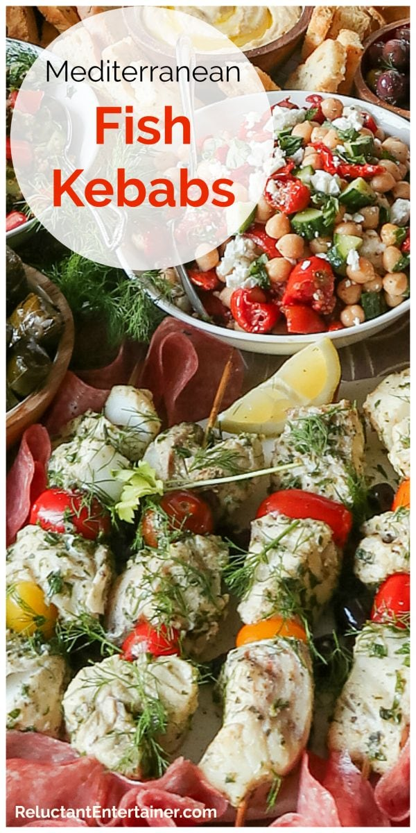 fish kebabs skewered with cherry tomatoes