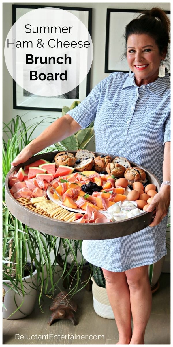 woman holding a Ham Cheese Brunch Board