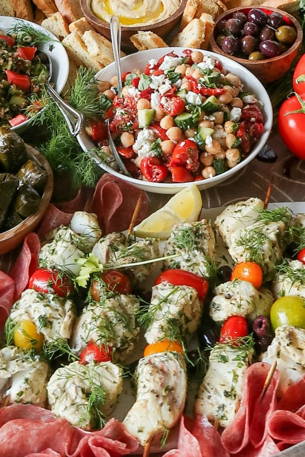 fish kebabs served with fresh dill and lemon slices