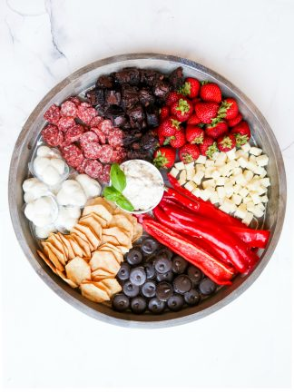 snack board with a bowl of cauliflower dip in the center