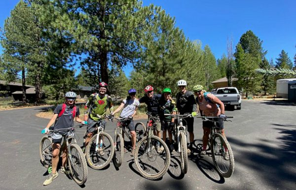 group of bike riders posing for a picture