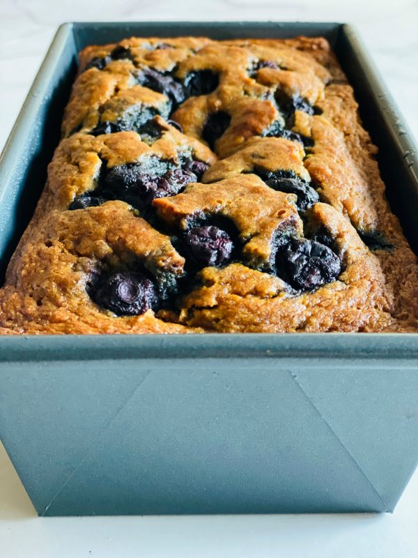 close up blueberries in a banana bread recipe