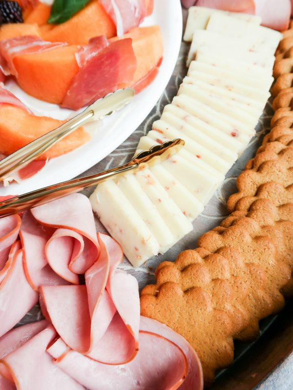 close up ham, sliced cheese, crackers