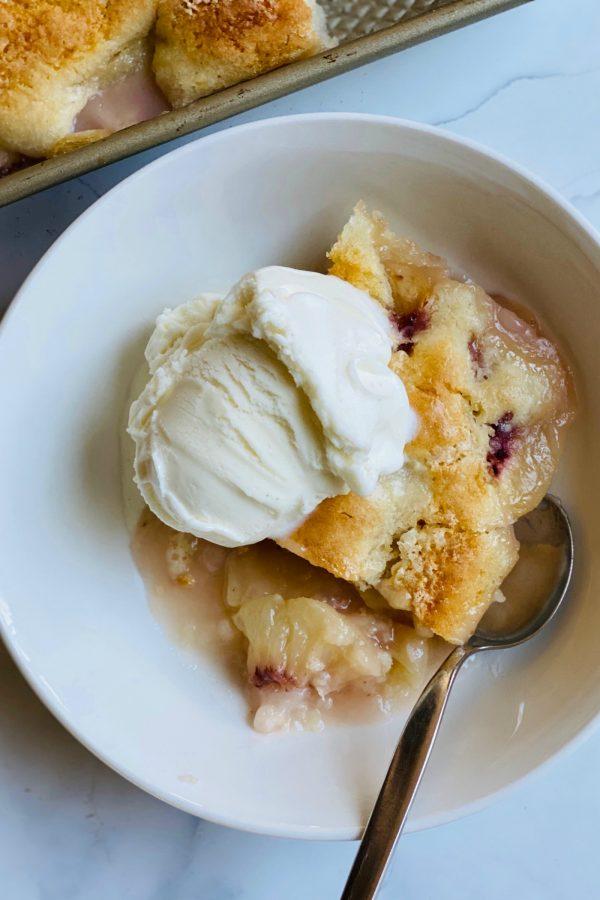 white bowl of peach cobbler