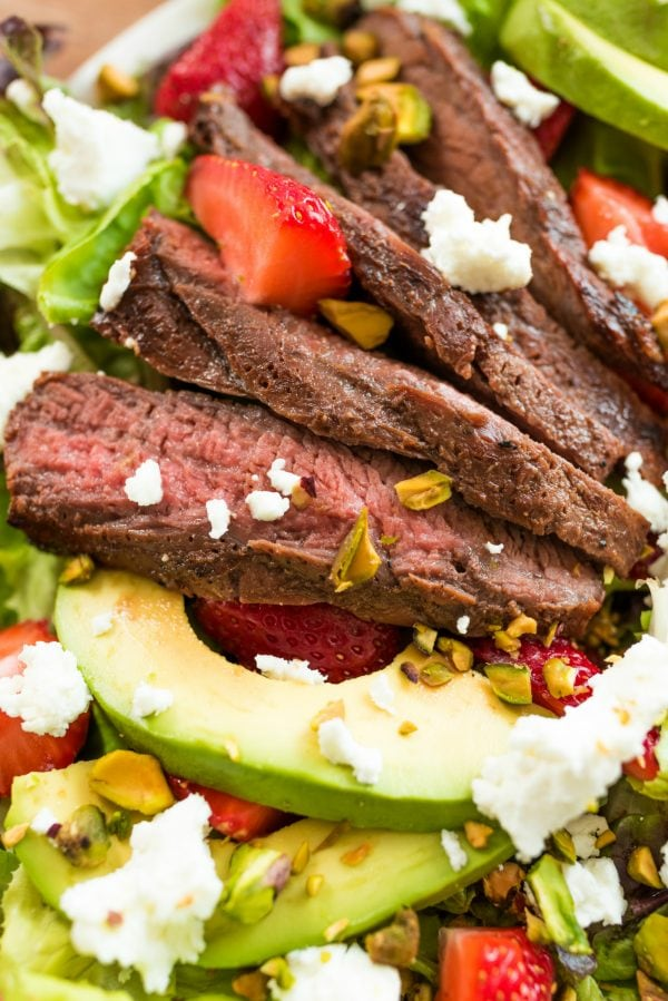 grilled steak with avocado and strawberries and pistachio nuts