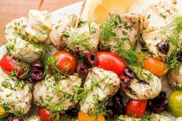 fish kebab chunks with tomatoes and fresh dill