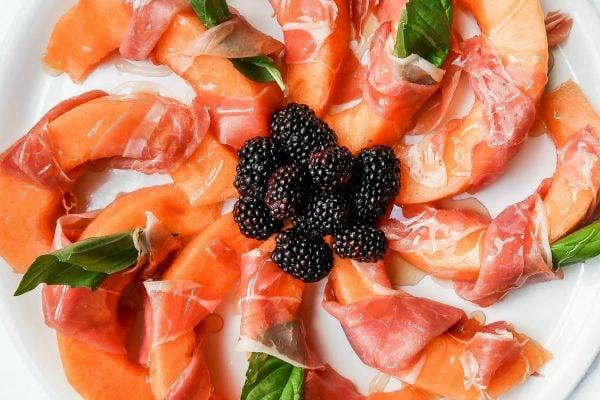 circular presentation of Prosciutto-Wrapped Melon Recipe