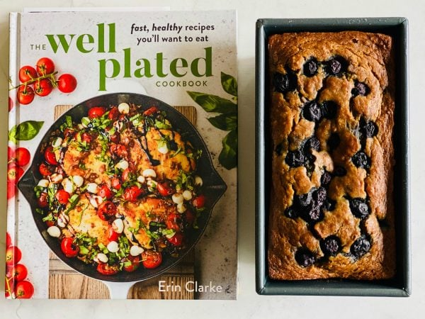 the well plated cookbook with a loaf of banana blueberry bread
