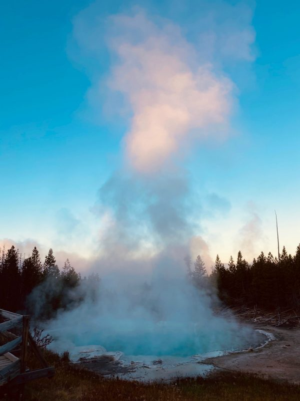 beautiful sunrise in Yellowstone National Park with geyser