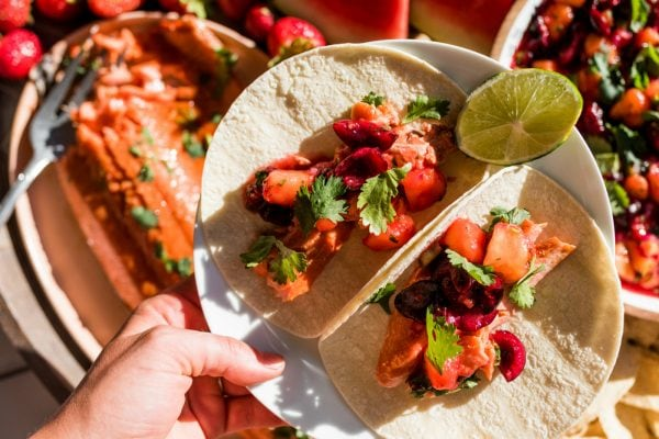 2 tacos with salmon and peach salsa