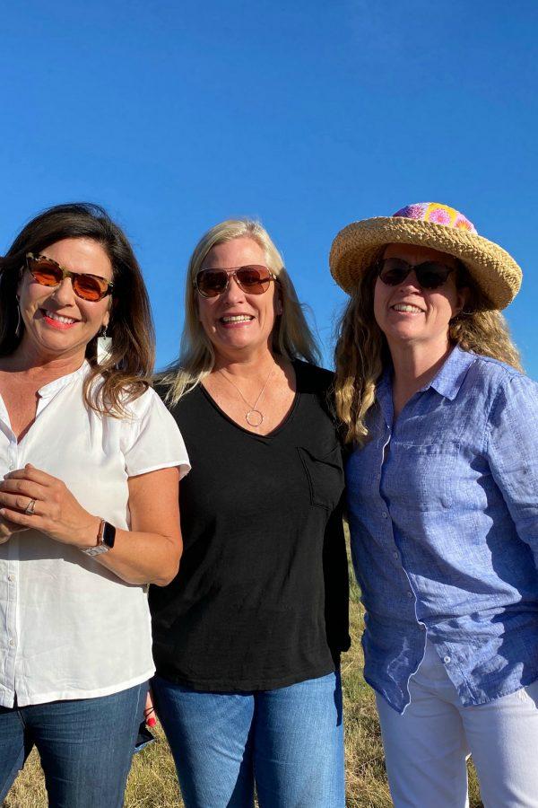 3 women in field on summer evening