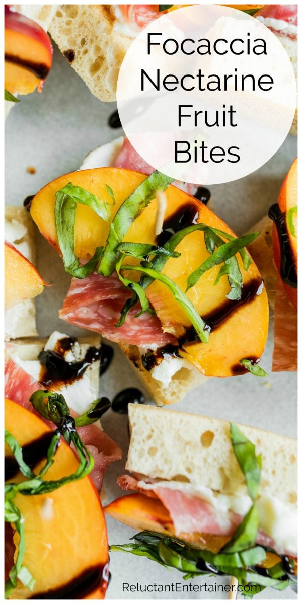 close up focaccia bread with a slice of nectarine and salami, with basil and balsamic drizzle