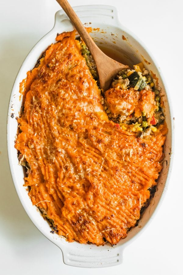 an oval dish of baked sweet potato Shepherd's pie