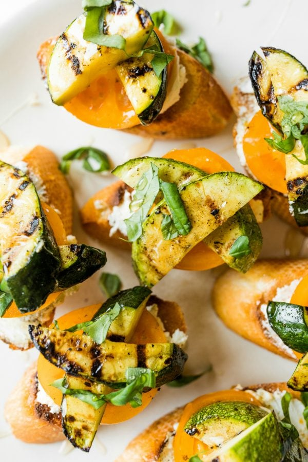 grilled zucchini toast with heirloom tomatoes