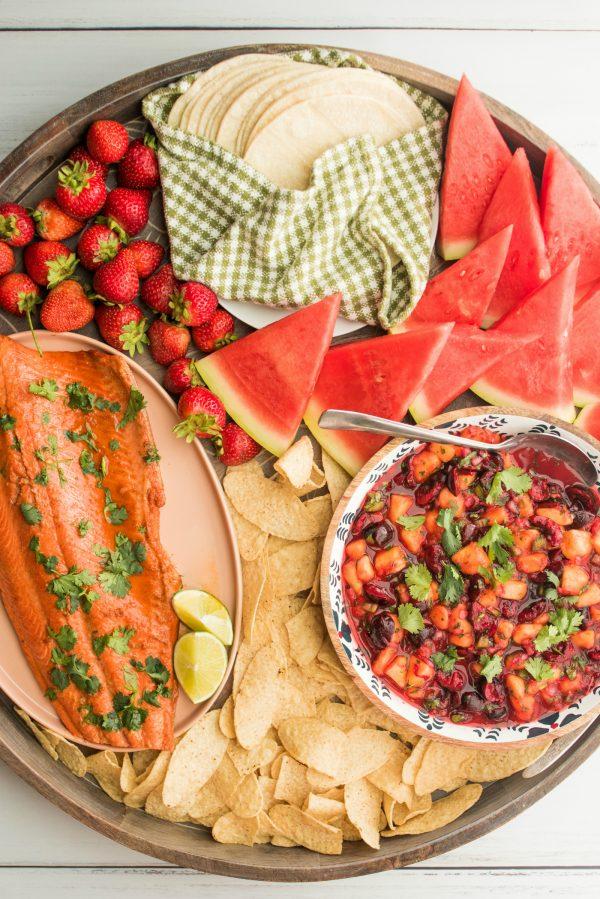 a round salmon taco dinner board