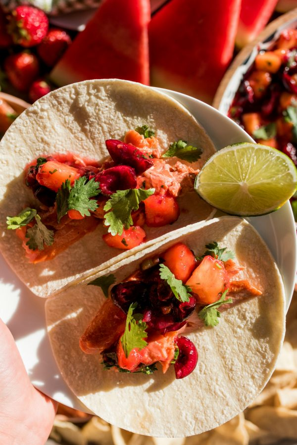 2 salmon tacos on a plate