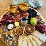 round wood breakfast tray with french toast