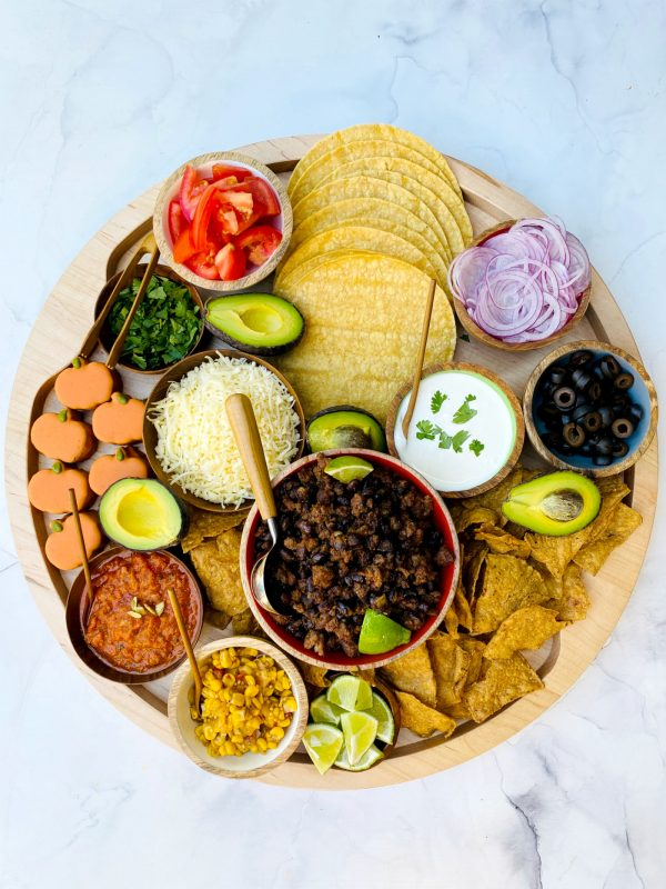 a pumpkin spice taco board with all the toppings