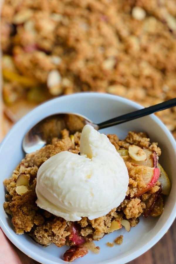 scoop of gelato on a bowl of Apple Pear Crumble Without Oats