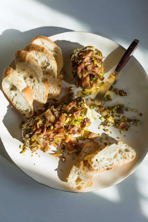 plate of Pistachio Bacon Date Cheese Logs with bread