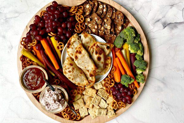 a round board of Pumpkin Empanadas