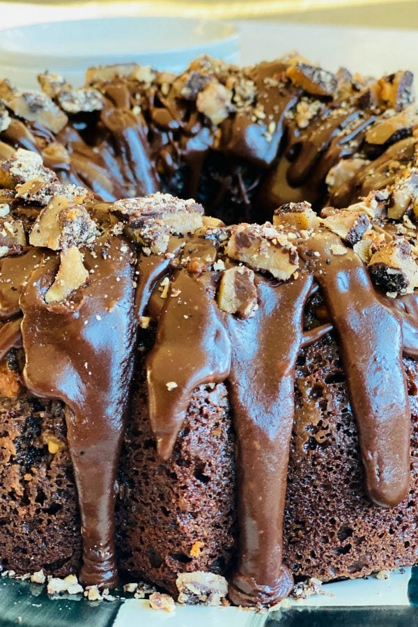 close up frosting on a Toffee Crunch Chocolate Bundt Cake