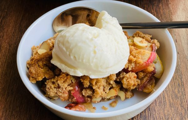 serving in a white bowl of Apple Pear Crumble Without Oats