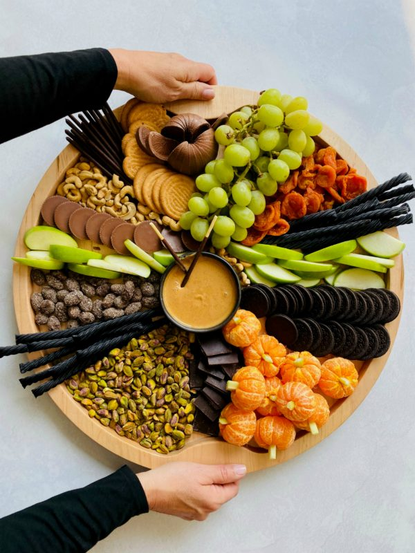 holding a halloween snack board
