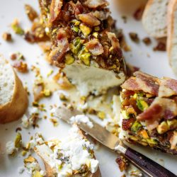 goat cheese log with bacon and pistachios