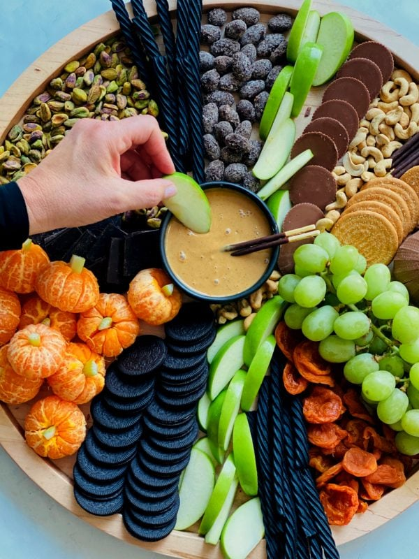 dipping halloween snacks in peanut butter