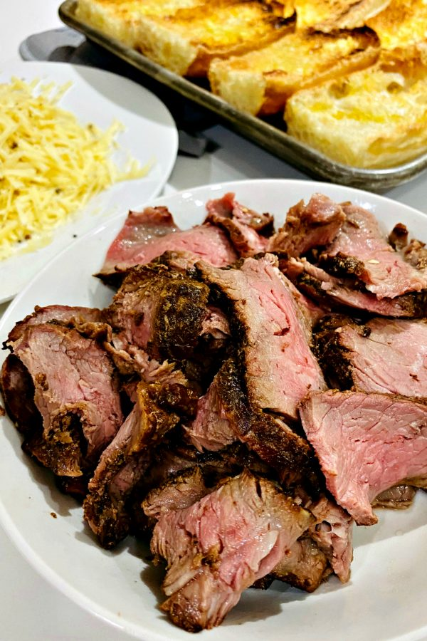 a plate of cooked, sliced steak