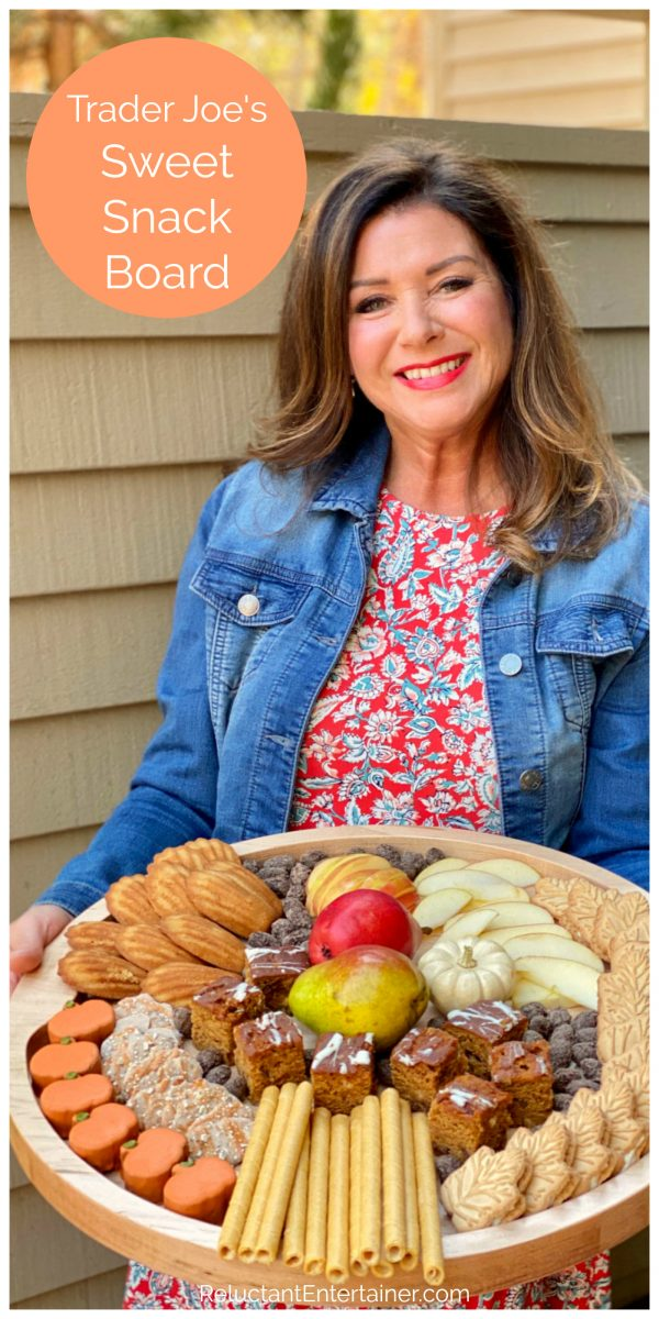 woman holding a fall snack tray