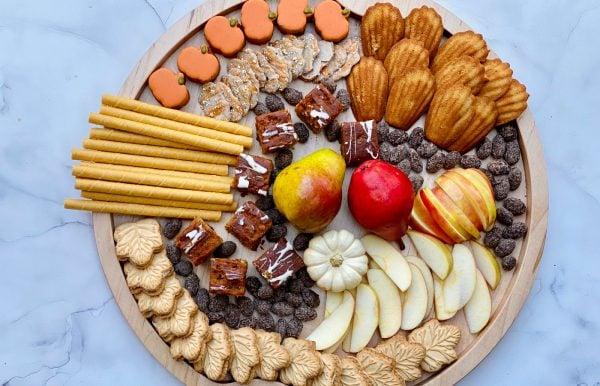 beautiful round dessert board with sweet snacks