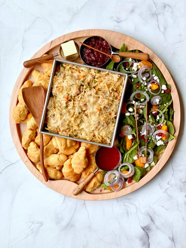 round dinner board with turkey tetrazzini