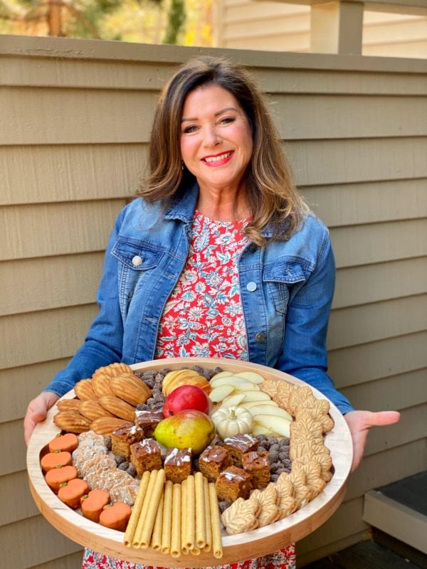 sweet snacks on a round wood board